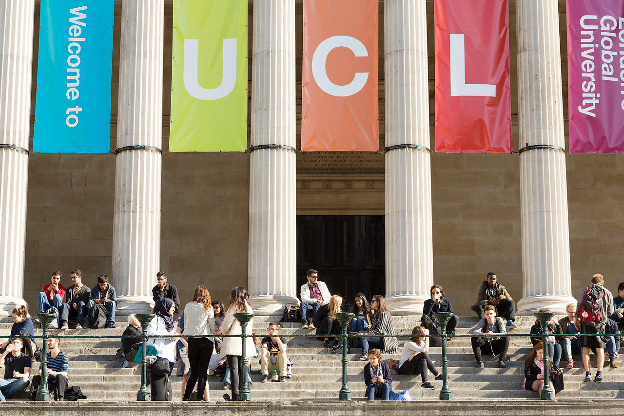 image of students sitting on UCL portico steps during Induction week